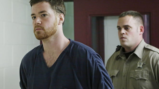 Cody Cousins is escorted to his initial court hearing on Jan. 23.
