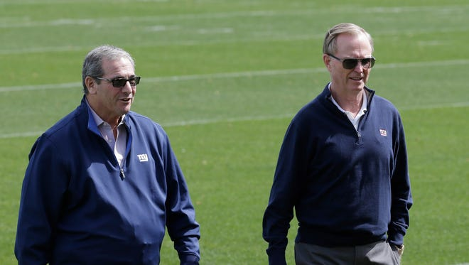 New York Giants general manager Dave Gettleman, left, and co-owner/team president John Mara talk as they walk off the field during the team's minicamp in East Rutherford, N.J., Tuesday, April 24, 2018.