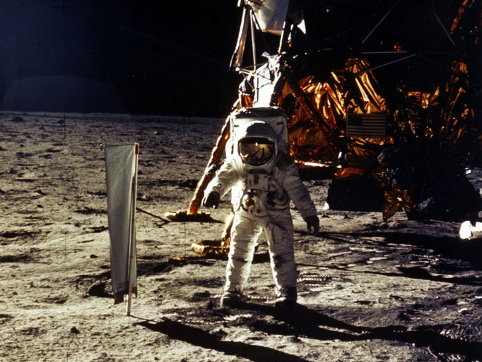 """The deployment of scientific experiments by astronaut Edwin """"Buzz"""" Aldrin Jr. is photographed by astronaut Neil Armstrong. Man's first landing on the moon occurred July 20, 1969, as Lunar Module """"Eagle"""" touched down  on the Sea of Tranquility on the east side of the moon. File photo/Getty Images 376713 20: (FILE PHOTO) The deployment of scientific experiments by Astronaut Edwin Aldrin Jr. is photographed by Astronaut Neil Armstrong. Man's first landing on the Moon occurred July 20, 1969 as Lunar Module """"Eagle"""" touched down gently on the Sea of Tranquility on the east side of the Moon. The 30th anniversary of the Apollo 11 Moon mission is celebrated July 20, 1999. (Photo by NASA/Newsmakers)"""