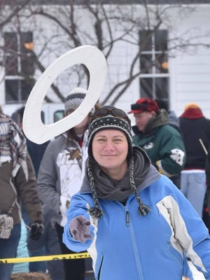 Karen Nordahl of Baileys Harbor competes in the ever-popular toilet seat toss competition last year during the Fish Creek Winter Festival.