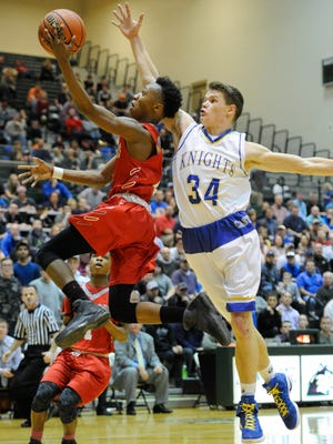 Bosse's Mekhi Lairy (2) goes to the basket against Castle's Noah Mclean (34) during the SIAC Tournament semifinals at North High School in Evansville, Thursday, Jan. 12, 2017. Castle beat Bosse 99-89.
