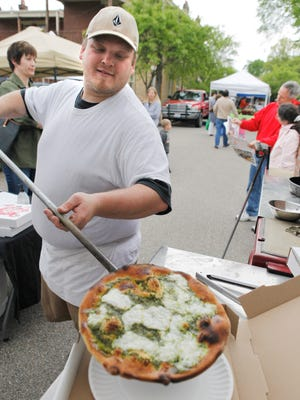A fresh baked pesto pizza at the Fireside Pizza stand at the the Wyoming Avenue Farmers' Market.