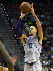 Lakers forward Kyle Kuzma shoots against the Portland