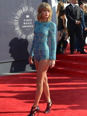 """In this Aug. 24, 2014 file photo, Taylor Swift arrives at the MTV Video Music Awards at The Forum in Inglewood, Calif. Swift is releasing her fifth album, """"1989,"""" on Monday, Oct. 27, 2014."""