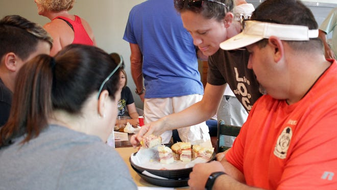 Folks sample some sandwiches at Filly's restaurant in Gallatin, TN on Thursday, June 21, 2018.