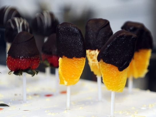 Edible Arrangements  rake of chocolate covered fruit.