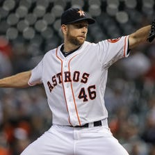 Sep 18, 2014; Houston, TX, USA; Houston Astros starting pitcher Scott Feldman (46) delivers a pitch during the first inning against the Cleveland Indians at Minute Maid Park. Mandatory Credit: Troy Taormina-USA TODAY Sports