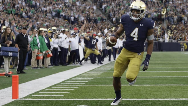 Notre Dame running back Avery Davis (4) runs during the second half of a game against Bowling Green on Saturday, Oct. 5, 2019, in South Bend, Ind. Notre Dame won 52-0.