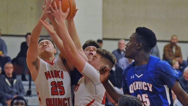 North Quincy's Aaron Huang, left, and teammate Colby St. Marie, center, fight for a rebound with Quincy's Adam Reinhardt, back, and Tresor Kalioua, right, during boys basketball at North Quincy High School, Friday, Jan. 24, 2020. Tom Gorman/For The Patriot Ledger