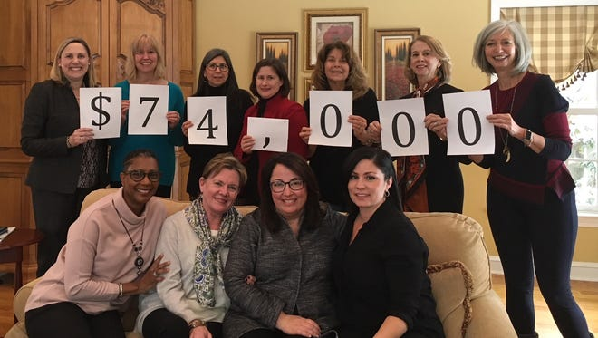 Impact100 SJ Members (seated, left to right) Kyle Ruffin, Cynthia Quinton, Judy Greenberg, Jenn Delmonte; and standing  Amy Leis, Kim Moon, Patti Withington, Barbara Little, Theresa DiVietro, Nancy Weber and Lee Albright, show how much they've raised toward a $100,000 goal.