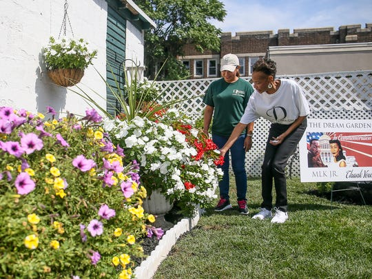 Retired New Brunswick Police Officer Jim Neal and his wife have dedicated a garden at their Joyce Kilmer Avenue home to Dr. Martin Luther King Jr. Debbie Neal, right, talks about her garden with neighbor Aurora Martinez of Daniel Landscaping on Aug. 25, 2016.