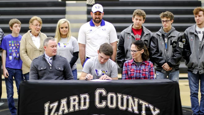 Izard County golfer Tyler Pemberton (front, center) signs his National Letter of Intent to play golf at Williams Baptist on Wednesday at Brockwell.