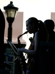 Christine Pschierer of Penfield plays the saxophone