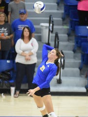 Mountain Home's Charlie Pierce skies for a kill during the Lady Bombers' win over Greene County Tech on Thursday night at The Hangar.