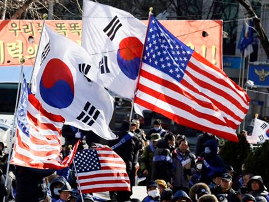 South Koreans wave the flags of South Korean and the