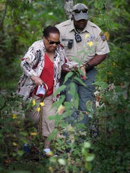 Marian Joyce is helped by Cheatham County Sheriff's