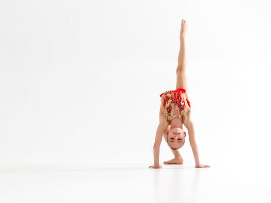 girl gymnast doing sports in rhythmic gymnastics on white background
