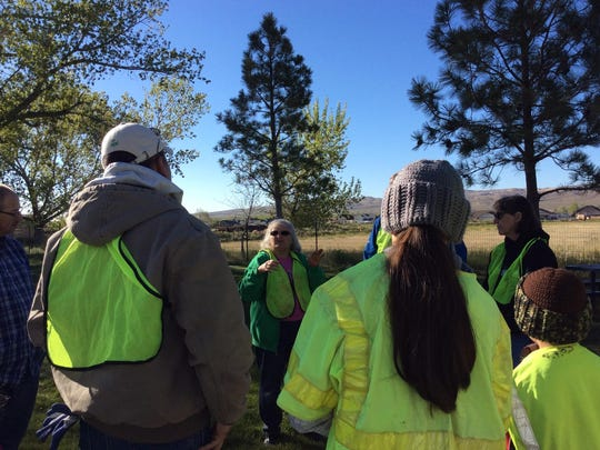 Councilwoman Sue Seidl addresses her team at the Mayor's Clean Sweep Saturday in Fernley.