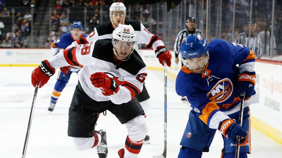 New Jersey Devils defenseman Colton White (68) pursues New York Islanders right wing Jordan Eberle (7) during the second period of a preseason NHL hockey game in New York, Monday, Sept. 25, 2017.