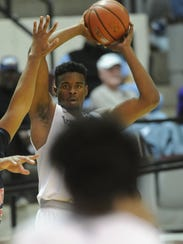ACU's Jalone Friday looks to pass the ball against