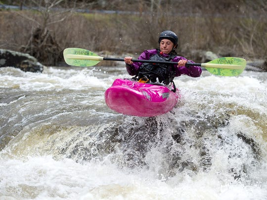 A kayaker takes flight as she rides a rapid March 25 on the Cheoah River. The damned river has several water release days throughout the year, and whitewater enthusiasts flock to the Cheoah River on these days to ride the rapids.