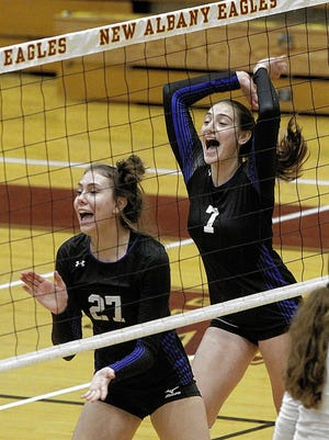 Margo Henderson and Zeynep Yildez of the Kilbourne girls volleyball team celebrate after winning a point during a 26-24, 25-15, 25-19 victory over host New Albany on Aug. 22.