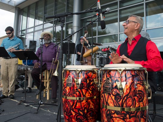 Bandleader Alberto Nacif plays the congas while performing with Cuban-style band Aguanko.