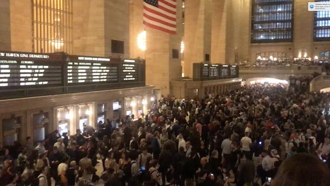 Commuters wait in Grand Central Terminal in New York City as all three lines were suspended due to severe weather on Tuesday, May 15th, 2018.