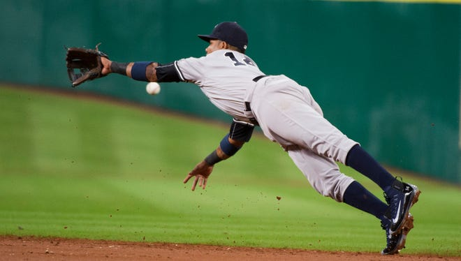 New York Yankees second baseman Starlin Castro dives but can't pull in a ball hit by Houston Astros' Marwin Gonzalez during the third inning of a baseball game Wednesday, July 27, 2016, in Houston.
