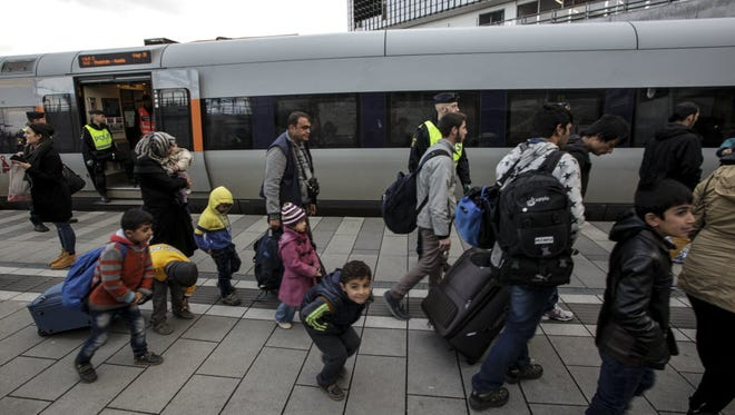 A group of migrants disembark from a train at the Swedish end of the bridge between Sweden and Denmark in Malmo, Sweden, on Jan. 4.