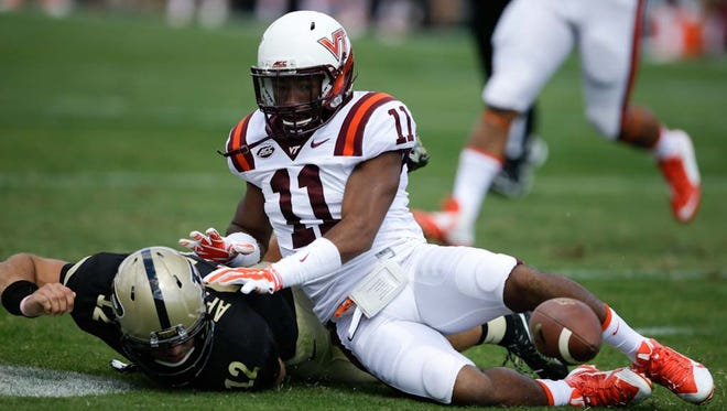 Virginia Tech's Kendall Fuller (11) tackles Purdue's Austin Appleby on Sept. 19, 2015, in West Lafayette, Ind.