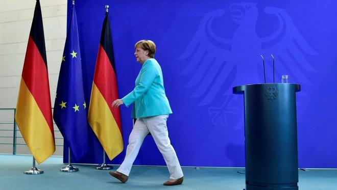 German chancellor Angela Merkel leaves after addressing journalists in Berlin on June 24.