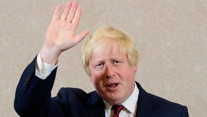 Brexit campaigner and former London mayor Boris Johnson waves after addressing a press conference in central London on June 30.