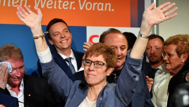 Christian Democratic Union candidate Annegret Kramp-Karrenbauer celebrates her party's win in Saarbrucken, south-western Germany,  March 26.