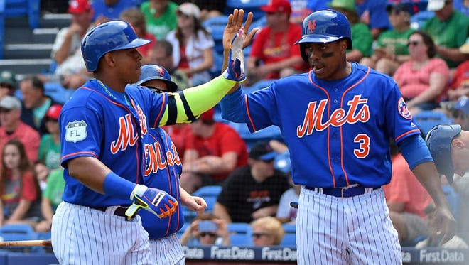 Mets' Curtis Granderson (right) with Yoenis Cespedes.