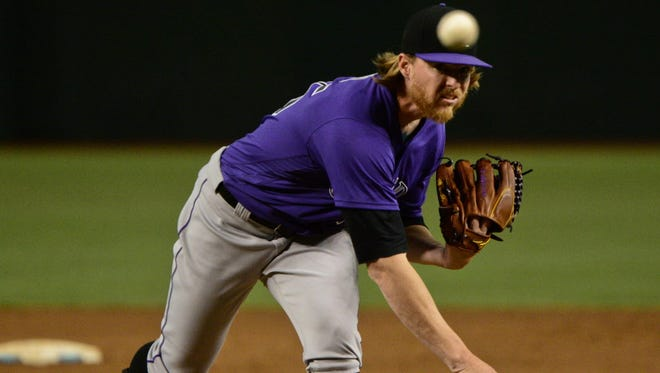 Colorado Rockies starting pitcher Jon Gray (55) throws in the first inning against the Arizona Diamondbacks at Chase Field.
