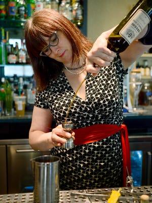Nightbell bartender Phoebe Esmon creates the restaurant's version of a manhattan, called a Carolingian.