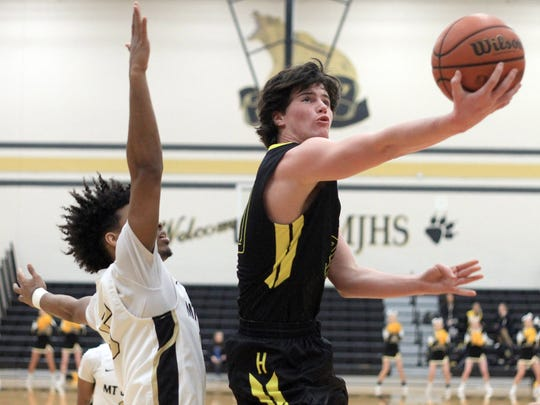 Hendersonville's Noah Taylor drives past Mt. Juliet's JC Crawford on Fri. Feb. 2, 2018.  Photo by Dave Cardaciotto