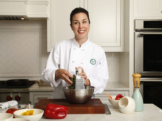 Personal chef Marcy Ragan of Long Branch, owner of Relish Your Chef, cooks in the kitchen of a Rumson home.