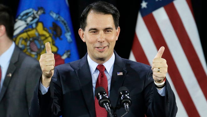 In a Tuesday, Nov. 4, 2014 file photo, Wisconsin Republican Gov. Scott Walker gives a thumbs up as he speaks at his campaign party, in West Allis, Wis.