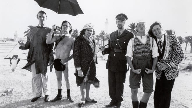 "In this undated publicity photo released by PBS, cast members of the original ""Monty Python's Flying Circus"" line up on a beach. From left are John Cleese, Terry Gilliam, Terry Jones, Graham Chapman, Michael Palin and Eric Idle."