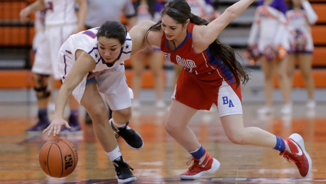 Eastlake's Caitie Aguirre gets tangled up with Bel Air's Destiny Ramirez as she steals the ball during their game Friday night at Eastlake High School.