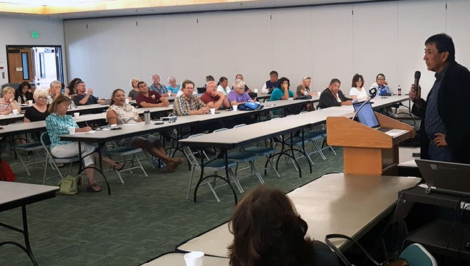 At right, Steve Grey, director of external and governmental affairs at the Navajo Transitional Energy Co., talks about the company's Community Benefit Fund during a workshop Aug. 31 at San Juan College.