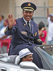 IFD Chief Ernest Malone waves during the Circle City