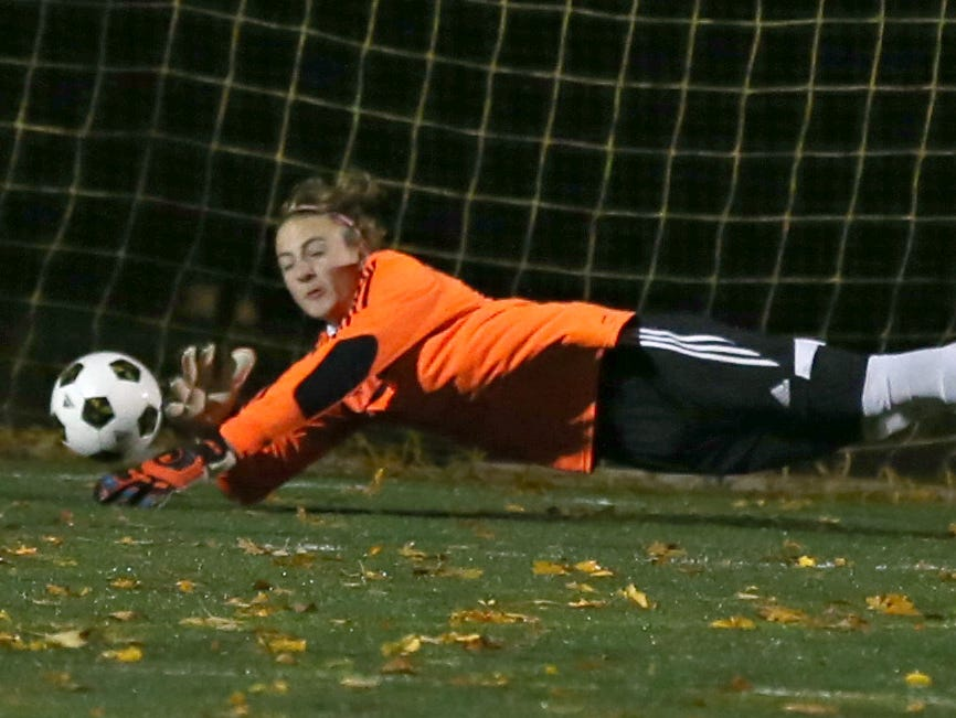 Victor goalie Alex Hunt dives but can't reach a shot and score by Fairport's Nick Guida during their Class AA semifinal game at Spencerport Thursday, Oct. 29, 2015.
