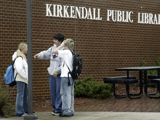 Kids from Northview Middle School hang out in front of the Kirkendall Public Library after school is let out.