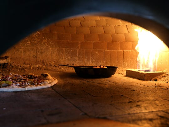 An order of wood fired wings and a pizza bake in the oven at Ferrari Pizza Bar in Chili.