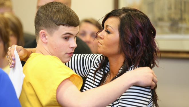 Kristi Blevins hugs her son after his sentencing for the shooting at Madison High School in 2016.