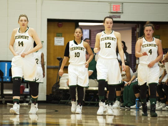 UVM players return to the court following a timeout.