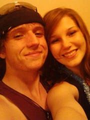 A Facebook photo dated July 2013 shows Dakota Wozniak and Olivia Ann Glaze. The two have been in a relationship for three years. Glaze, 17, went missing early July 25 from her home in Henderson.
